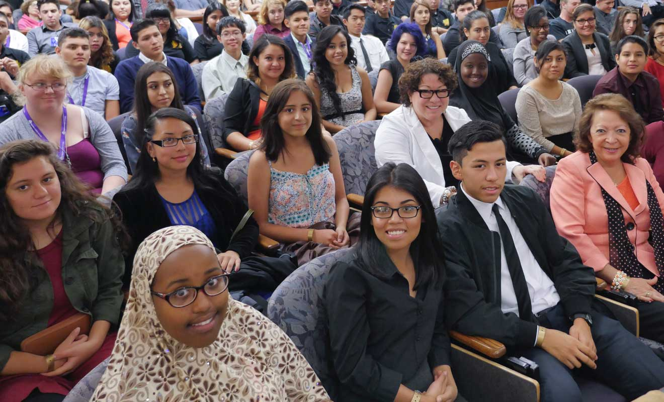 U.S. Supreme Court Justice Sonia Sotomayor (second row, wearing a white jacket) with Aurora West College Preparatory Students.  Judge Christine Arguello is pictured in the front row. Photo by Glenn Asakawa.