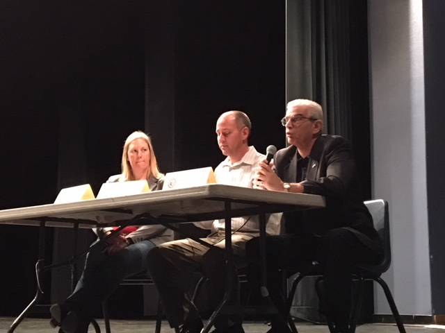 Jayne Malorni, Roger West, and Dr. Lou Grillo demonstrate WTP Hearing